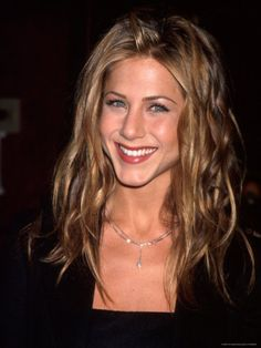 After landing her breakout role as Rachel Green on Friends, Jennifer Aniston took the lead as America's sweetheart. The ELLE cover girl has starred in a slew of big-screen hits and graced countless best-dressed lists. Here, her best looks. Jennifer Aniston Style, Jennifer Aniston Pictures, Hair Evolution, Evolution Of Fashion, Jeniffer Aniston, John Aniston, Brown Blonde Hair, Blonde Honey, Honey Hair