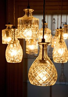 Use glass decanters, vases, or bottles to invent a unique and finished look for your pendant chandelier or lamp base.