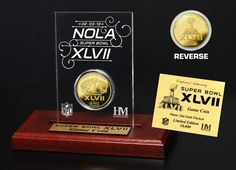 """Order your Super Bowl 47 Gold flashed Flip Coin Desk Top Acrylic. This coin is a 24KT Gold flashed replica Super Bowl Flip Coin is beautifully displayed in a 3.5"""" x 5"""" Acrylic with custom Super Bowl XLVII Etching (Engraving). A Limited Edition of 10,000 and officially licensed by the National Football League. Made in the USA. $54.95"""