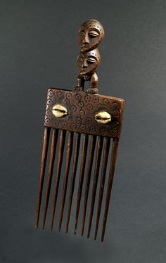 Africa   Comb from the Lega people of DR Congo   Wood and cowrie shells   Mid 20th century