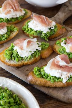 Spring Pea Crostini, spring appetizer made with peas, herbs and a hint of citrus that's then served on crostini with prosciutto and burrata on top!