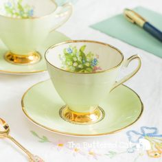 Lovely PAIR of pastel green harlequin teacups by TheButteredCat