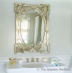 An antique mirror hanging above the bathroom basin in Aerin Lauders home
