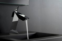Graff Immersion series vessel sink faucet is the shape of number 7 with a slight curve at the tip. The faucet is high enough and is mounting on the counter. The operating lever is fixed at the base of this vessel sink faucet. All the parts are flat and elongated.