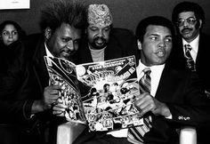 The world heavyweight champion is pictured with promoter Don King holding a comic book in which Ali is shown beating Superman.