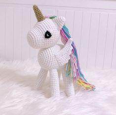 Who doesn& love amigurumi unicorns? It is easy to describe a very cute unicorn . Crochet Unicorn, Unicorn Pattern, Cute Cartoon Characters, Diy Crafts To Do, Cute Unicorn, Rainbow Unicorn, Amigurumi Toys, Knitted Dolls, Free Crochet