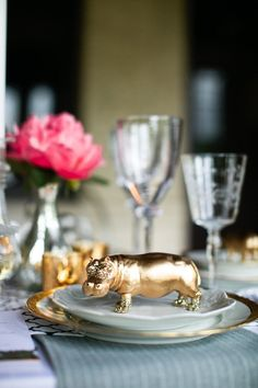 Animal themed escort cards. Plastic animals spray painted gold