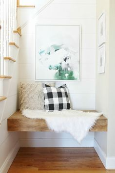 floating bench in little nook with great abstract art above it