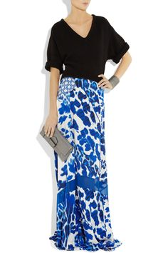 A brilliant patchwork of bright-blue prints adds drama to Just Cavalli's flowing silk-satin maxi skirt. Balance the bold color and formal silhouette with a classic black knit for understated after-dark glamour. Shown here with: 3.1 Phillip Lim top, Philippe Audibert cuff, Givenchy shoes, Reed Krakoff bag.