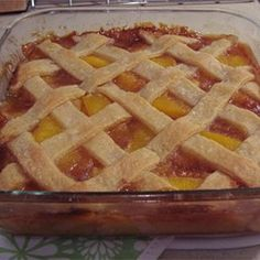 Flaky pastry enclosing peaches flavored with lemon and orange juice and spiced with nutmeg and cinnamon. Old Fashioned Peach Cobbler, Southern Peach Cobbler, Homemade Peach Cobbler, Delicious Desserts, Dessert Recipes, Yummy Food, Yummy Eats, Tasty, Peach Pound Cakes