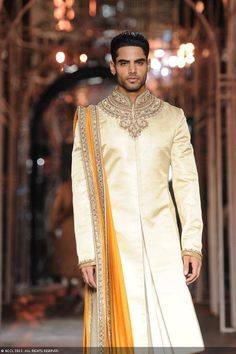 A model walks the ramp for designer Tarun Tahiliani during the Grand Finale of the India Bridal Fashion Week (IBFW) held in New Delhi. Indian Groom Wear, Indian Bridal Wear, Indian Wear, Indian Male, Indian Ethnic, Indian Men Fashion, India Fashion, Mens Fashion, Ethnic Fashion