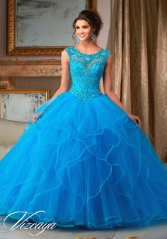 Stunning and elegant, Mori Lee Vizcaya Quinceanera Dress Style 89116 is sure to light up the room during any girl's Sweet 15 party. Made out of tulle, this Quince dress features a sleeveless sheer ill
