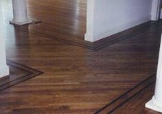 A border or feature strip in your hardwood floor can highlight a focal point in your room, visually guide foot traffic, or visually separate living areas in an open space.