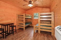 Beds and a table inside a cabin at Pigeon River Campground.