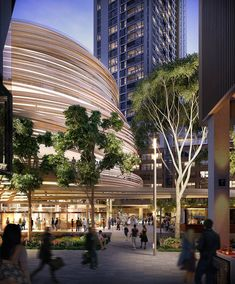 This circular building surrounded by strips of wood will be a new library for Sydney
