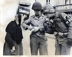 Two members of the Military Police with an elderly woman. Le Jour Le Plus Long, Soldier Haircut, Kilroy Was Here, Cherbourg, Military Police, World War One, D Day, Women In History, Vietnam War