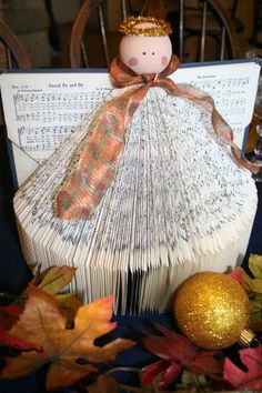 How to make an Hymnal Angel. I love this idea, but don't know if I could use a favorite hymnal... some of my favorite books.