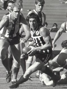 Russell Ebert 4 Time Magarey Medallist (1971, 1974, 1976, 1980) 3 Time SANFL Premiership Player (1977,1980,1981) Six Time PAFC Best and Fairest (1971, 1972, 1974, 1976, 1977, 1981) One Time PAFC Leading Goalkicker (1968) PAFC Captain 1974-1978, 1983-1985 Adelaide South Australia, Iconic Photos, Football Team, Manchester United, Liverpool, The Unit, Club, Black And White, Teal