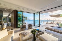 This phenomenal 7 bedroom home resides on prestigious La Gorce Island, with views stretching from Biscayne Bay all the way to Downtown Miami. Built on a lot of Dream Home Design, My Dream Home, Modern Glass House, Modern Miami, Beach Mansion, Futuristisches Design, Dream Beach Houses, Expensive Houses, Mansions Homes