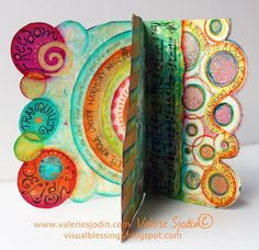 """This year I have a shape of the year as well as a word. My word is AIM and my shape, concentric circle. The circle is filled with loads of symbolic meaning to me, and is encompassed by the word """"shalom."""" It is more than peace. It is wholeness, completeness in every way. As this art journal developed it became clear that the attributes I list are all qualities to aim for.  I have also been inspired by Mary Brack's blog post """"Collage Therapy"""" at http://mewithmyheadintheclouds.blogspo..."""