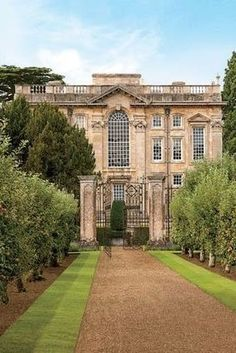 Rows of apple trees lead to the entrance of Easton Neston…