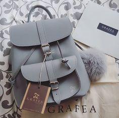 Grafea grey leather backpack with pom pom www.grafea.com