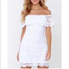 White Lace Off-the-shoulder dress Floral lace creates an elastic, off-the-shoulder neckline, draping into a scalloped ruffle atop the bodice. Body skimming, sheath silhouette also ends in scalloped lace. Hidden zipper with clasp at back. Lulu's Dresses Strapless