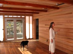 Bedroom is lined with shiplap cedar siding and tongue and groove cedar ...