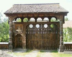 Traditional Romanian carved wooden gate in Hoteni, Maramureş Romania People, Hut House, Visit Romania, Wooden Gates, Stone Houses, Bucharest, Beautiful Places To Visit, Illustrations And Posters, Architecture Details