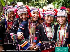 Akha women celebrating in traditional dress with headpieces.