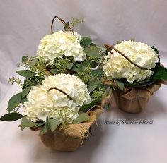Rustic Hydrangea centerpiece (with burlap)...sparkle added with shot of glitter spray on the twig and burlap?