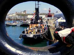 https://flic.kr/p/ehQYbo | Steam Tug Challenge from the Rope Hole of the Shieldhall | Southampton Maritime Festival  The Steam Tug Challenge is a true national treasure and is proud to be registered in the National Historic Fleet. Challenge was the last steam tug to have worked on the Thames, but is best known for the role she played in Operation Dynamo, evacuating of troops from the shores of Dunkirk in 1940.  www.stchallenge.org/