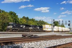 Two shots from Berea, Ohio this morning featuring Norfolk Southern trains on the Chicago Line. First is stack train NS 21G. Second is NS 421, an empty coke hopper train with a single locomotive for power 9/27/2016