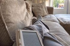 Person reading ebook on couch - Cindy Prins/Moment Mobile/Getty Images