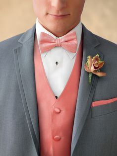 Coral accessories help bring a grey tuxedo to life.