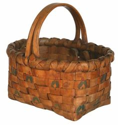 """A very unique and interesting Northeast Indian made potato stamped basket, probably Penobscot.   It would be just another Indian basket except for the fact that it has a rarely seen """"split"""" handle that is hand hewn out of a single piece of wood and then split and separated."""