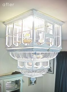 before & after: birdcage chandelier.  | Design*Sponge - would these birds not poop on your head!? That's a terrible idea! Lol