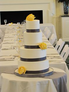 yellow and grey wedding cake