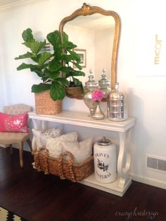 Add freshness to your space with a live plant.  Place it atop a console table in a basket, to add height and colorful interest.  Balance it with large vases.  Accessories available at HomeGoods.  Sponsored Pin.