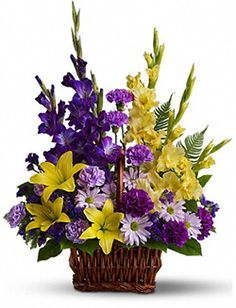 Appropriate to send to a residence as well as to a funeral home, memorial service or wake, the Basket of Memories flower arrangement features a bright purple and yellow color scheme. It's a lovely basket of fresh sympathy flowers, and a uniquely thoughtful gesture.
