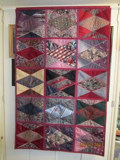 Quilt was made to honor the life of a husband and father by using his ties to make a colorful decorator quilt. Ties were stabilized, pieced and embellished with decorative machine stitches.