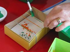 Snap Painting - paint stretched rubber bands and snap them! Great fine motor activity - fun study of cause and effect.