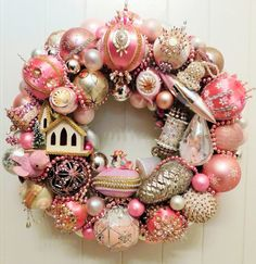 Cotton Candy is a beautiful Shabby, Cottage Chic wreath, handmade with mostly vintage pink ornaments from the 60s, 70s, and 80s. The collectible ornaments include many especially ornate vintage sequin and beaded ornaments. Other ornaments include beautiful hand painted glass, a Jewel Brite angel teardrop, a mica bird candy holder, and a cute little putz church. An old mercury glass pinecone wrapped in bullion is a special highlight. The entire wreath has been trimmed with gorgeous pink…