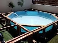Wooden pallet in a plastic pool