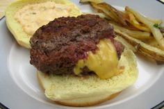 Jucy Lucy Cheeseburger from Food.com:   I saw this on the Travel channel an had to give it a try. It looked like heaven. A Jucy Lucy is basiclly two beef pattys put together with the sides pinched and American cheese in the middle. I was literally overcome with greed on this . I am sure you will understand once you try this. Yum Yum. Enjoy!   p.s. I didnt spell the name it wrong, this is the way it is spelled at Matt's Bar in Minneapolis..