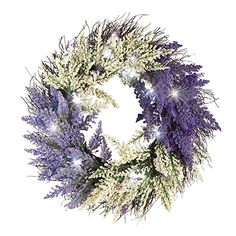 Lighted Bicolor Lavender Twig Wreath. Lavender, dark purple and cream flowers are accented with white LED lights that add sparkle and shine