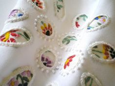 Small  bordered pictures that look like snippits cut out of other pieces-designer...Karen Ruane.