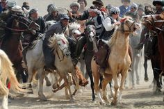 March 23, 2012. Afghan men compete with horses during the traditional Afghan sport Buzkashi in Mazar-i Sharif, Afghanistan.