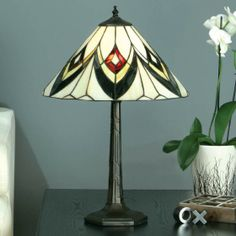 Odeon Table Lamp Odeon Table Lamp, classical Art Deco lines in contrasting red, black and yellow American Art Glass. H:	570 W:	390 D:	390 Bulbs:	1 x 60 E27 Fittings:	DB132L1 Shade:	TV150SHM