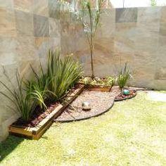 Palmera rubelina con duranta y piedra de rio jardines - Fotos de jardines modernos minimalistas ...